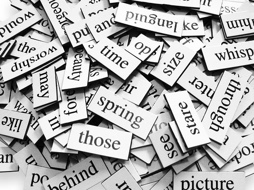 Large pile of various words placed over white background.